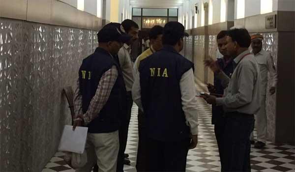 विधानसभा में विस्फोटक जांच मामले में पूछताछ करती एनआईए टीम